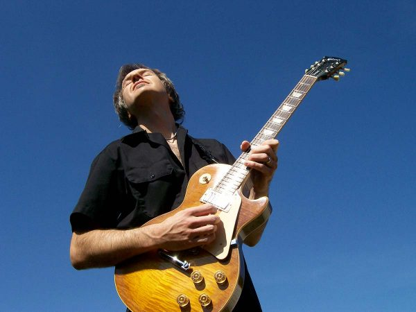 Dave Celentano and Blue Sky Background